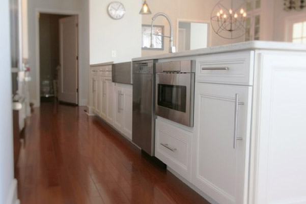 white cabinets with dark wood floors
